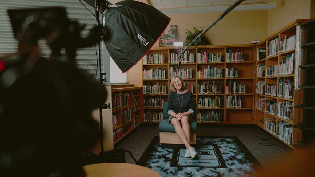 Video production of an interview with a business woman sitting on a chair