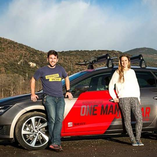 Branded video content featuring a man and women leaning against a car